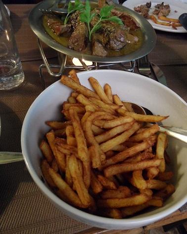 Here it comes! Faux filet paré de la sauce maison Mademoiselle accompagnés de frites maison. Photo © genevafamilydiaries.net