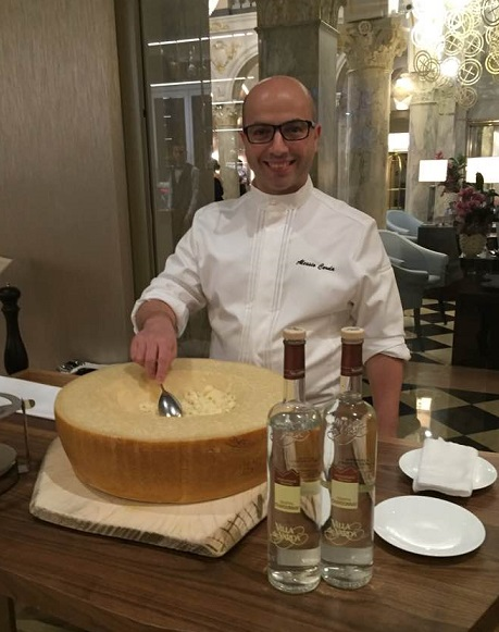 Chef Alessio Corda and the wheel of Parmigiano Reggiano. Photo © 2016 genevafamilydiaries.net
